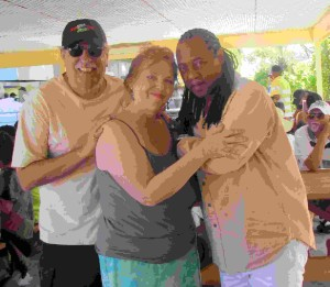 Boca Raton residents Howard and Terri Appell with Ted Mills of Blue Magic on the Soul Train Cruise